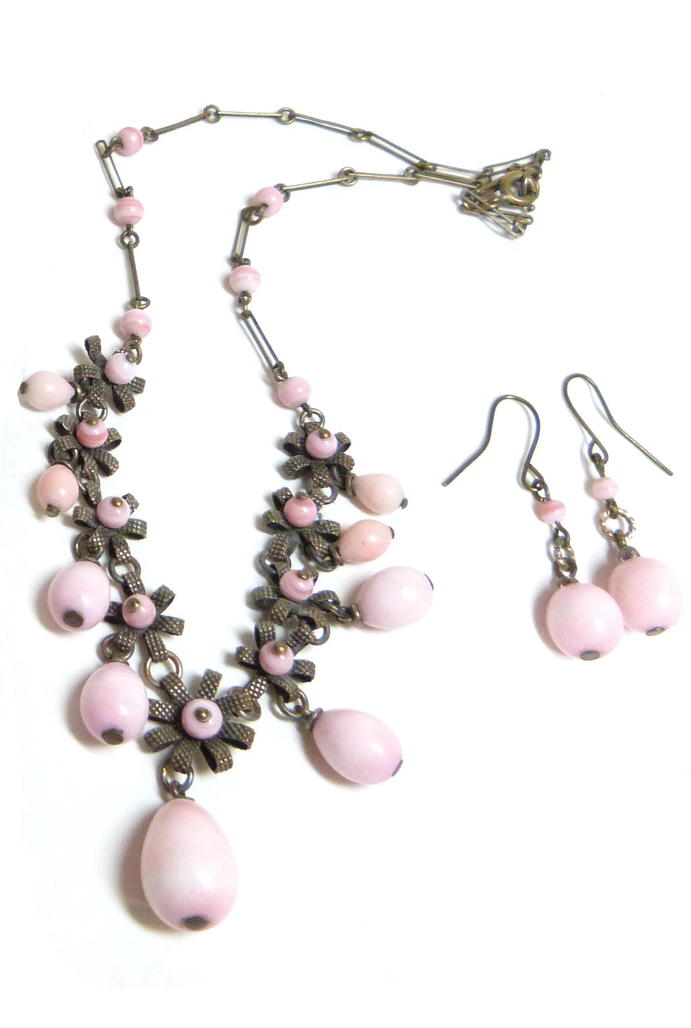 A pair of vintage earrings with a matching necklace